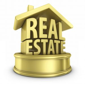 The words real estate sitting on a round pedestal capped with a house roof all in gold - home mortgage tips